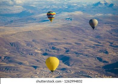 GOREME, TURKEY - December 2018: Colorful Hot air balloons in the air over Cappadocia (Kapadokya), Göreme Turkey