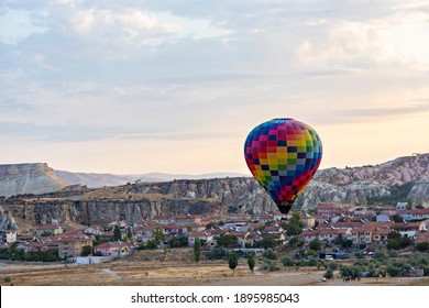 GOREME, TURKEY - December 2018: Colorful Hot air balloons in the air over Cappadocia (Kapadokya), Göreme Turkey