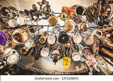 GOREME, TURKEY - December 2018: Old lamps hanging in antique shop in Goreme, Turkey