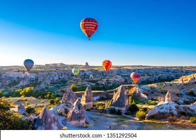 Goreme, Turkey - July 05, 2018 : People are watching Hot Air Balloon flight in Goreme Town.