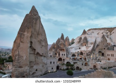 GOREME, TURKEY - JULY 28, 2007: Hoodoo rocks in  Goreme town in Cappadocia. It is the center of Goreme national park listed as UNESCO World Heritage since 1985