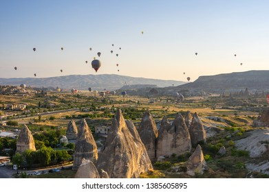 GOREME, TURKEY - JUNE 23, 2015: The great tourist attraction of Cappadocia - balloon flight. Cappadocia is known around the world as one of the best places to fly with hot air balloons. Goreme, Turkey
