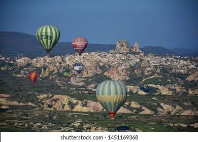 Goreme, Turkey - May, 03, 2019: Hot air balloons over Cappadocia at sunrise