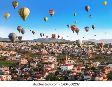 GOREME, TURKEY - MAY 19, 2015: Balloons flying over the small town of Goreme in Cappadocia, Turkey