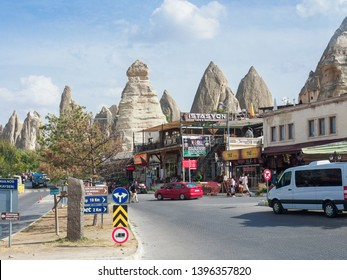 Goreme, Turkey - October 08, 2018:  The street view of Goreme, Nevsehir Province, showing the commercial buildings in the foreground and the fairy chimneys rock formation in the background.