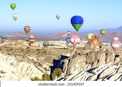 GOREME, TURKEY - OCTOBER 21, 2014: Hot Air Balloon Flights over the spectacular and breathtaking lunarscape of Cappadocia. Hot air ballooning is very popular thanks to the amazing landscapes.