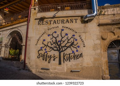 GOREME, TURKEY: restaurant on the street, decoration-tree with blue eyes. Goreme is town in Cappadocia, Nevsehir Province, Central Anatolia, Turkey.