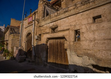 GOREME, TURKEY: Street in the old town with a wooden door. Goreme is town in Cappadocia, Nevsehir Province, Central Anatolia, Turkey.
