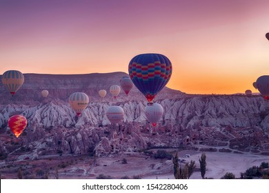 Goreme,Turkey- 17 October, 2019:Hot Air balloons flying tour over Mountains landscape autumn sunrice Cappadocia, Goreme National Park, Turkey nature background.