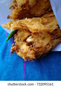 Gorengan  Bakwan (indonesia fried snack,  made from various vegetables such as Cabbage,  carrot,  bean sprout and other) with green chilli