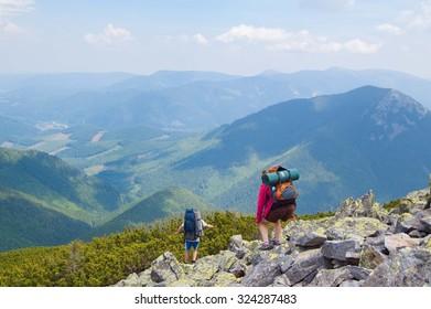 Gorgan Carpathian mountains, tourists descend from the mountain