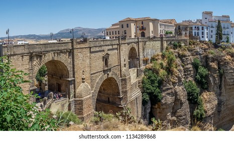 A gorge in the city of Ronda Spain, Europe on a hot summer day with clear blue skies