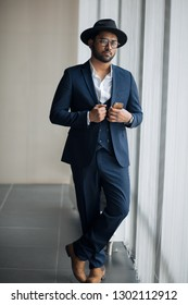 gorgeous actor with smartphone looking at the camera. full length photo. . mob. stylish . dandy