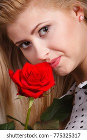 Gorgeous adorable woman holding red rose flower. Romantic portrait of beautiful young lady.
