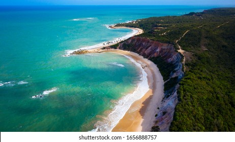 Gorgeous aerial drone view of the amazing tropical Tabatinga beach located in João Pessoa in the state of Paraìba, Brazil.