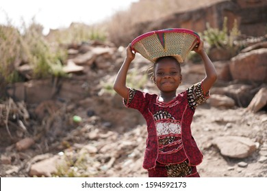 Gorgeous African Girl with Tothy Smile and Basket on Head