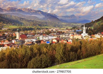 Gorgeous Austria. The picturesque small town is wonderfully illuminated by the sun.  Mountain valley in the Alps