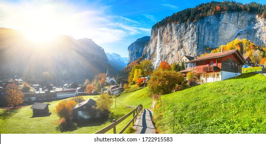 Gorgeous autumn landscape of  alpine village Lauterbrunnen with famous church and Staubbach waterfall. Location: Lauterbrunnen village, Berner Oberland, Switzerland, Europe.