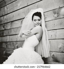 Gorgeous beautiful brunette  bride in white dress.