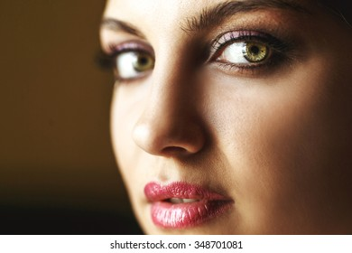 Gorgeous beautiful exotic bride with green eyes posing face closeup