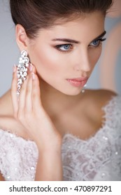 Gorgeous beauty bride with wedding makeup and hairstyle wear jewelry. Amazing beautiful young woman bridal style and marriage fashion