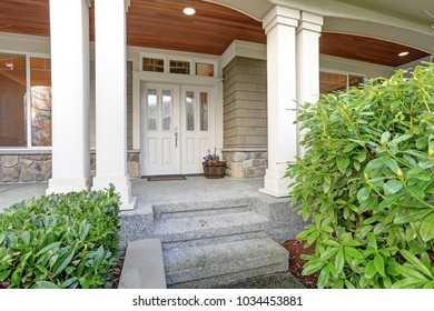 Gorgeous big Craftsman home with cozy covered porch with columns.
