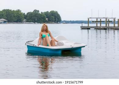 A gorgeous bikini model enjoying a day on the water