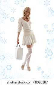 gorgeous blond with shopping bag and snowflakes