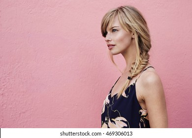 Gorgeous blond woman against pink background