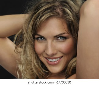 gorgeous blond woman with very sexy smile