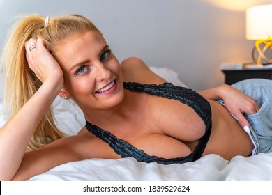 A gorgeous blonde model enjoys a day at home before work