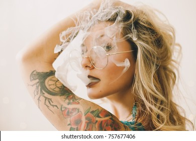 Gorgeous Blonde Smoking with Gold Glasses