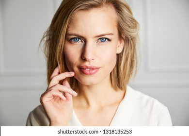 Gorgeous blue eyed blond woman looking at camera