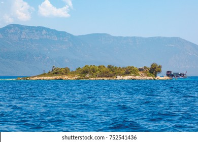 Gorgeous blue sea and mountains background and Gokova bay Marmaris. A tour boat in Sedir island sea.