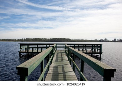 a gorgeous blue sky florida day by a pond with green wharf