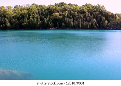 Gorgeous blue-green color in body of water where glaciers have melted, but frigid waters did not mix with warmer lake water below.