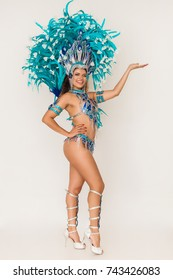 Gorgeous brazilian samba dancer wearing blue traditional costume