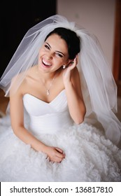 Gorgeous bride bursts of laughing
