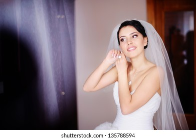 Gorgeous bride is getting ready at home