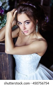 Gorgeous bride young woman in a wedding dress with perfect makeup and hairstyle