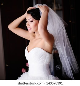 Gorgeous brunette  bride is getting ready  in the morning