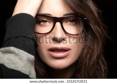 f80bc4601ae Gorgeous brunette fashion model girl with casual hairstyle wearing trendy  glasses. Close-up beauty