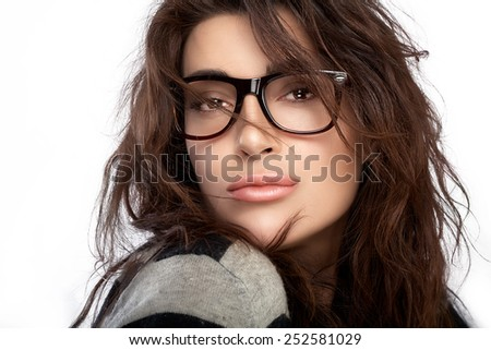 ac679b023af Gorgeous brunette fashion model girl with casual hairstyle wearing trendy  glasses. Beauty fashion portrait isolated