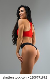 Gorgeous brunette in sportswear rearview