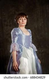 Gorgeous Brunette woman wearing baroque violet dress