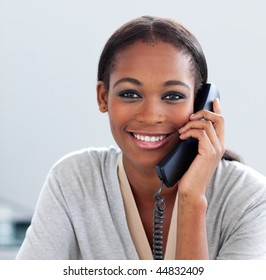 Gorgeous businesswoman smiling on phone