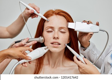 Gorgeous caucasian female with delightful emotional face enjoying modern skin care and treatment technologies. All together at the same time. Cosmetology skin care. Aesthetic facial treatment Concept.