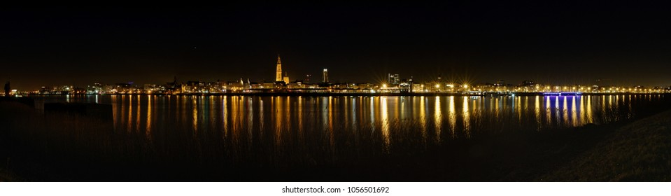 A gorgeous cityscape / landscape of Antwerp. This panorama shows the beauty of the city. The lights of the river Schedt shines. A Panorama of 180°.
