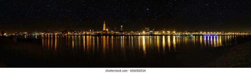 A gorgeous cityscape / landscape of Antwerp. This panorama shows the beauty of the city. The lights of the river Schedt shines. A Panorama of 180°. Stars are shining over the city.