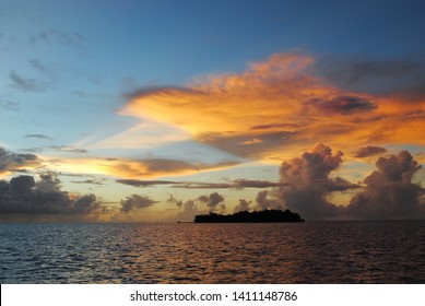 Gorgeous clouds over the silhouette of Managaha Island, Saipan at sunset